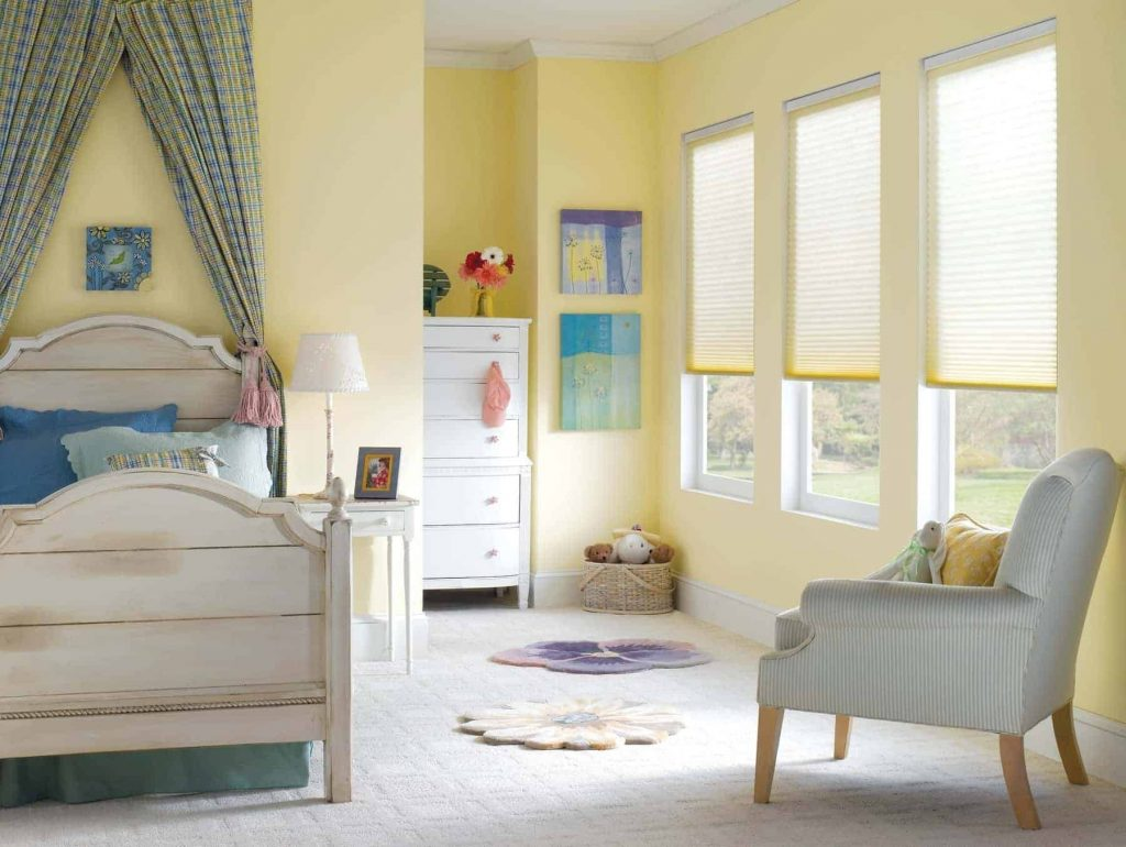 honeycomb shades in a girl's bedroom