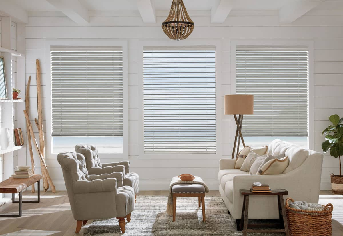 living room with wood blinds installed on the windows