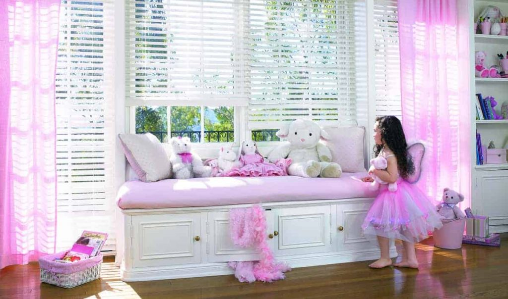 faux-wood blinds in girl's bedroom
