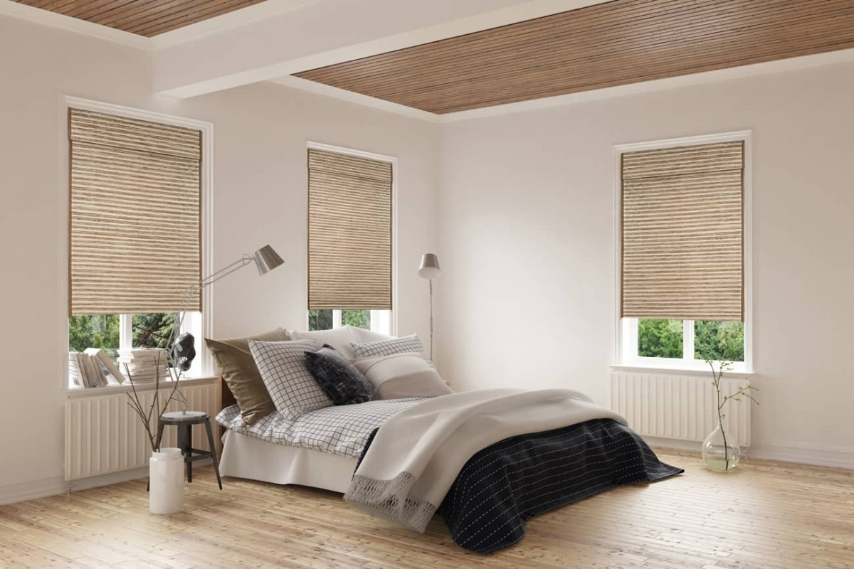 roman shades in a bedroom