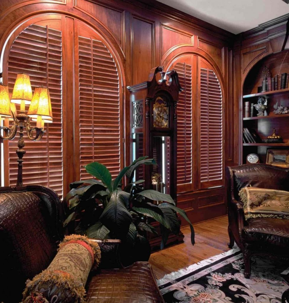 shutters in arched windows in living room